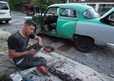 Taxi driver working on his car