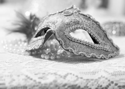 Masquerade mask and pearls
